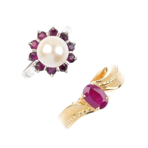 882 - Two gem-set dress rings. To include an oval-shape ruby single-stone ring, with asymmetric shoulders,...