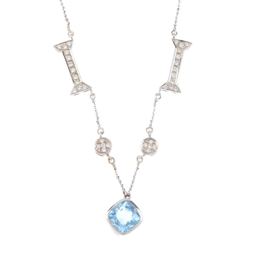 884 - A topaz and diamond necklace. The front designed as vari-shape brilliant-cut diamond panels, intersp...