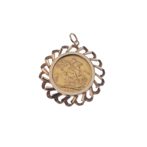 887 - A 1970s 9ct gold mounted Sovereign pendant. The sovereign, with openwork grooved surround. AF. Hallm...