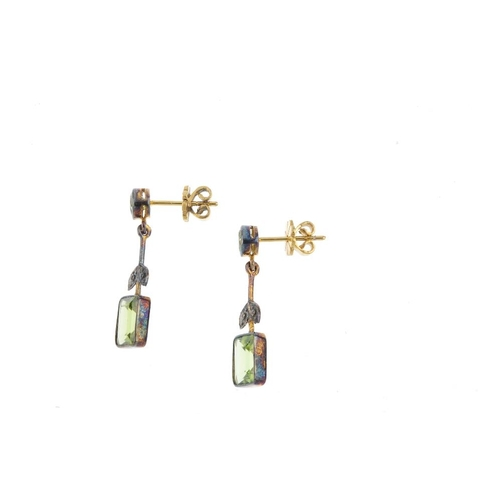 888 - A pair of peridot earrings. Each designed as a circular-shape peridot collet, suspending a foliate b...