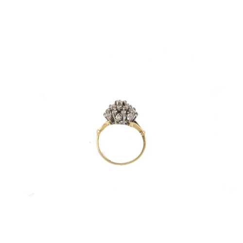 897 - An 18ct gold diamond cluster ring. Designed as a brilliant-cut diamond, within a similarly-cut diamo...