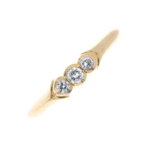90 - A diamond three-stone ring. The slightly graduated brilliant-cut diamonds, to the plain band. Estima...