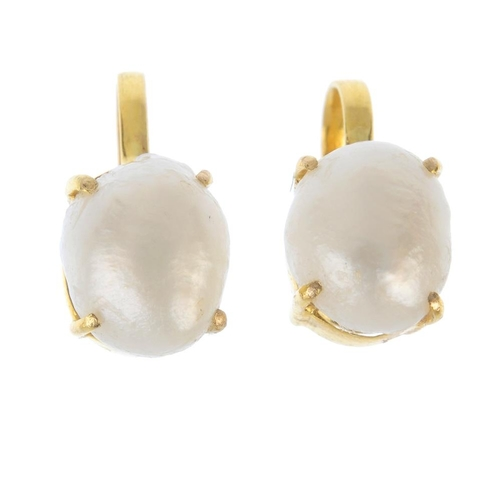 901 - A pair of cultured pearl earrings. Each designed as a freshwater cultured pearl, within a claw setti...