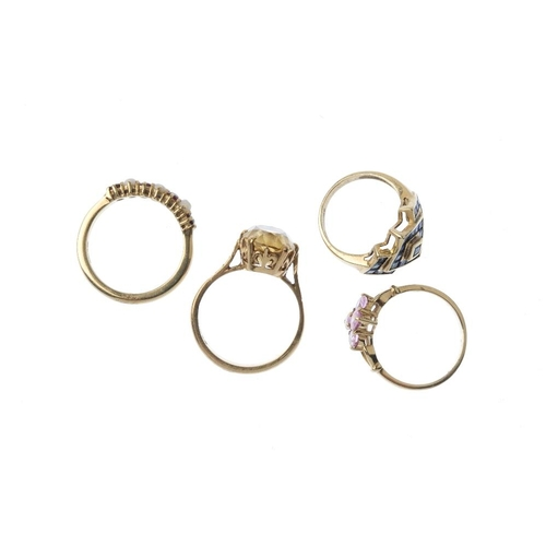 903 - Four 9ct gold gem-set dress rings. To include a citrine single-stone ring, a sapphire geometric dres...