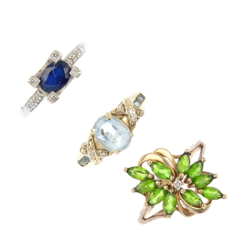 905 - Three diamond and gem-set rings. To include a 9ct gold diopside and diamond floral dress ring, a 9ct...