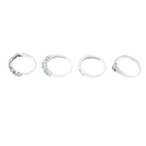 91 - Four 9ct gold diamond and gem-set rings. To include an emerald and diamond quatrefoil half-circle et...