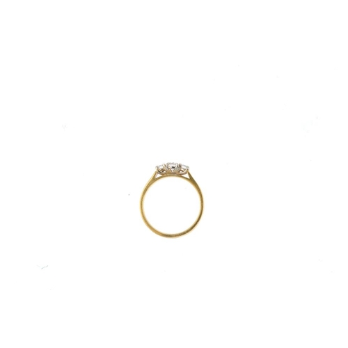 914 - A platinum diamond three-stone ring. The slightly graduated brilliant-cut diamond line, with plain b...