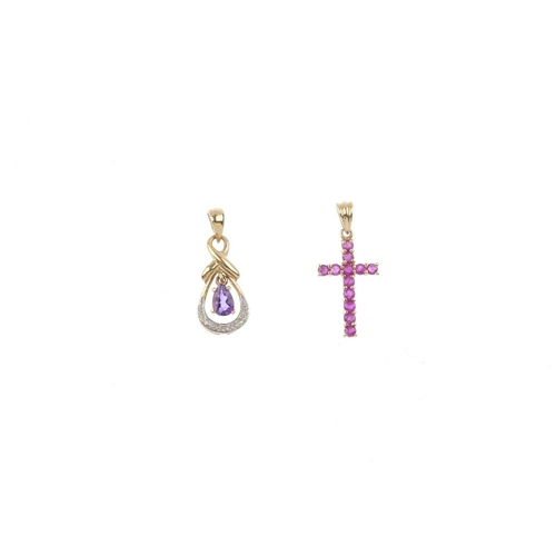 917 - Four 9ct gold gem-set pendants and a brooch. To include a ruby cross pendant, an amethyst and diamon...