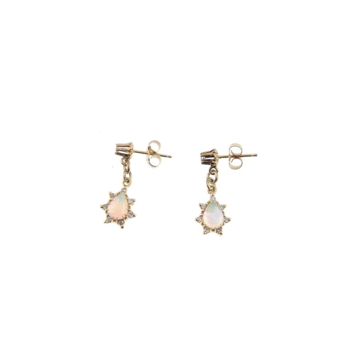 921 - A selection of opal jewellery. To include a pair of opal and diamond cluster earrings, an opal and d...