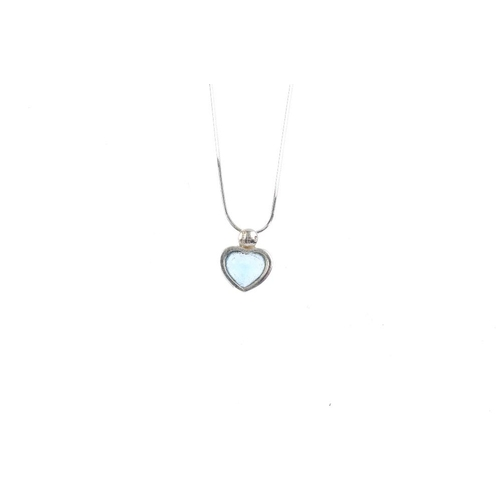 922 - Three 9ct gold diamond and gem-set pendants. To include a heart-shape outline diamond accent pendant...