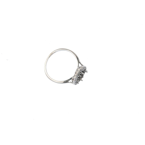 927 - A diamond cluster ring mount. Designed as a single-cut diamond cluster, with vacant circular setting...