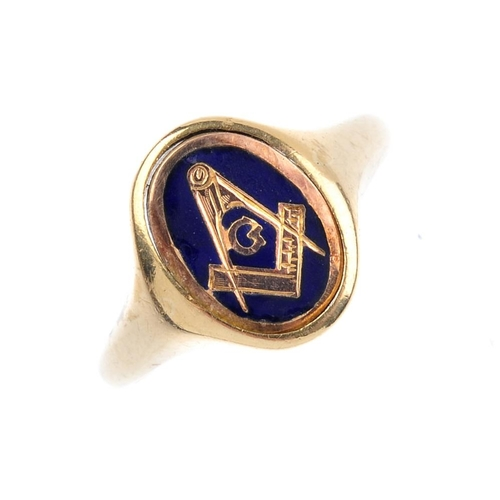 928 - A mid 20th century 9ct gold Masonic swivel signet ring. The oval-shape blue enamel panel with Masoni...