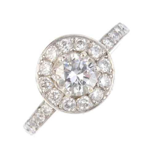 93 - A diamond dress ring. The brilliant-cut diamond, with similarly-cut diamond surround and sides. Prin...