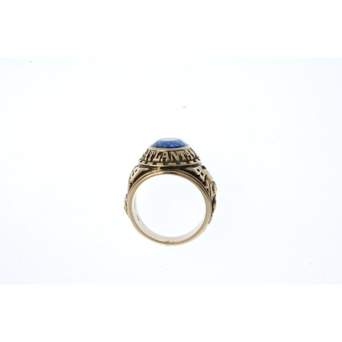 932 - A gentleman's paste ring. The oval-shape blue paste, within an embossed surround which reads 'Carver...