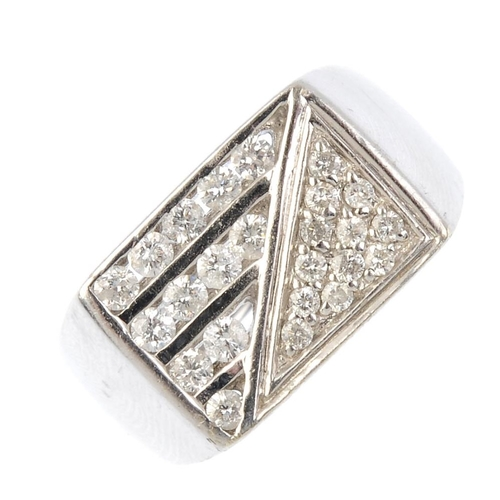 936 - A gentleman's 9ct gold diamond dress ring. Designed as a rectangular-shape panel with pave-set diamo...