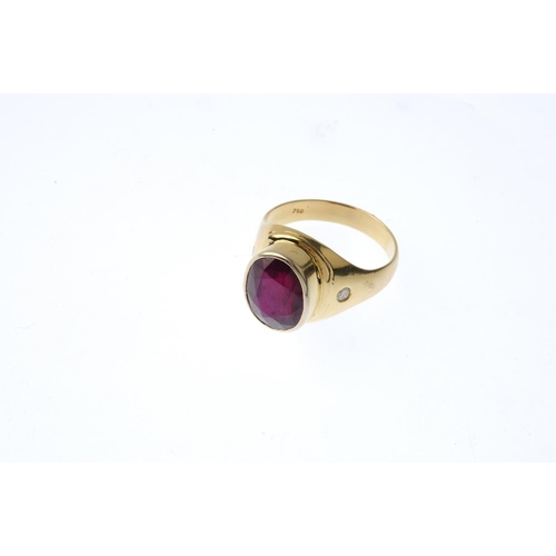 939 - A gentleman's glass-filled ruby single-stone ring. The oval-shape glass-filled ruby collet, with bri...