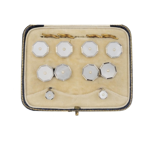 949 - A gentleman's early 20th century 9ct gold mother-of-pearl and split pearl dress set. To include four...
