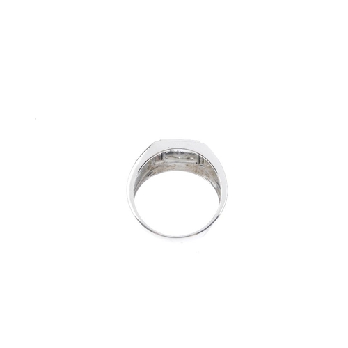 956 - A gentleman's 9ct gold diamond dress ring. The brilliant-cut diamond square-shape panel and tapered ...