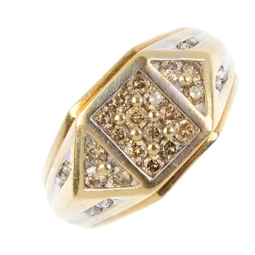 960 - A gentleman's diamond dress ring. Of geometric design, the pave-set diamond square-shape panel, with...