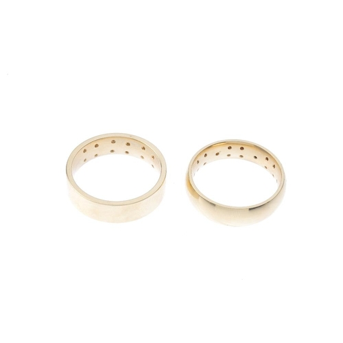 963 - Two 9ct gold diamond band rings. To include one designed as three brilliant-cut diamond quatrefoil p...