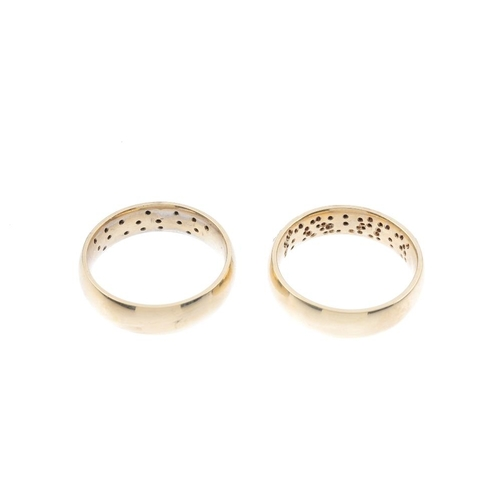 965 - Two 9ct gold diamond band rings. The first diamond as a single-cut diamond curved panel and plain ba...