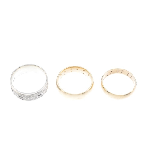 967 - Three 9ct gold band rings. To include one designed as five brilliant-cut diamond quatrefoil panels i...