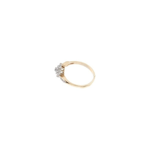 97 - A 9ct gold diamond cluster ring. The single-cut diamond, with a similarly-cut diamond double surroun...