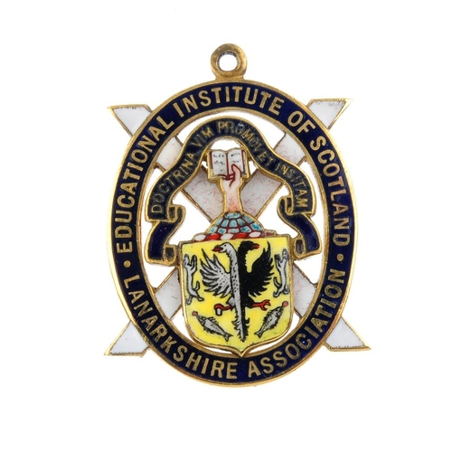 979 - A 1970s 9ct gold enamel medallion. Designed as a vari-colour enamel coat of arms shield and cross, w...