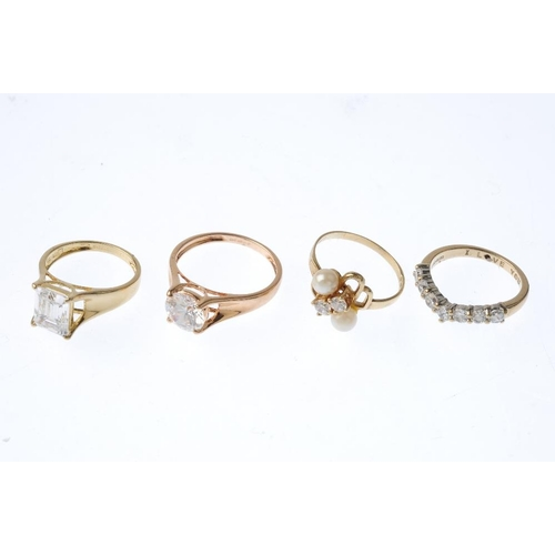 98 - Four gold cubic zirconia and imitation pearl rings. To include two 14ct gold cubic zirconia single-s...