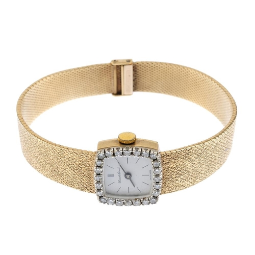 982 - BUECHE GIROD - a 1960s 9ct gold diamond cocktail watch. The cream dial, with hourly applied baton ma...