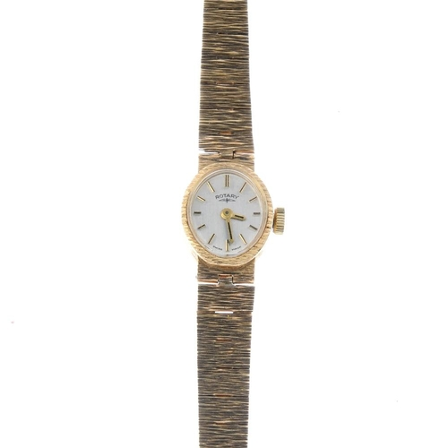 985 - ROTARY - a lady's 1970s 9ct gold wristwatch. The oval-shape grey dial and baton markers, within a te...