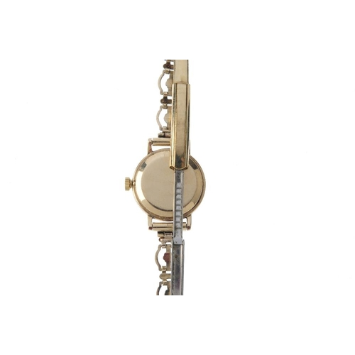 987 - ROTARY - a lady's watch. The circular cream dial, with openwork floral motif bracelet. Length 17cms....