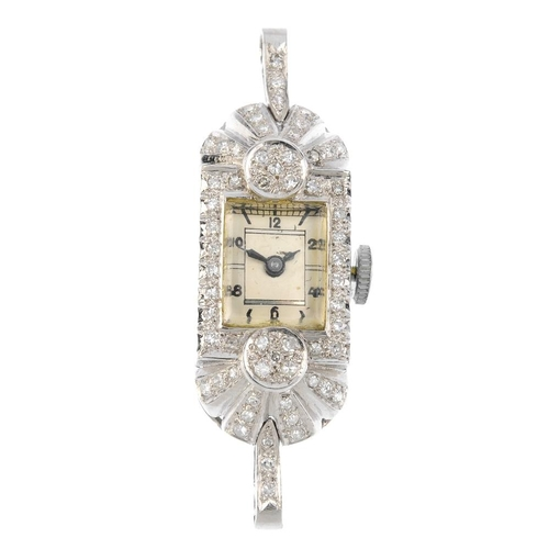 992 - An Art Deco diamond watch head. The cream rectangular-shape dial, with black numerals and baton mark...