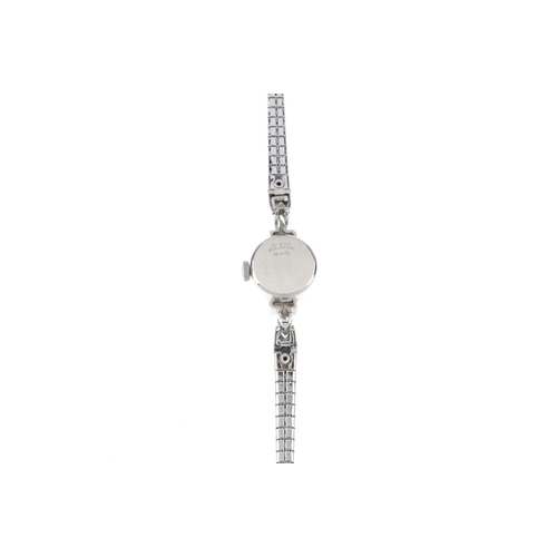995 - A ladies paste cocktail watch. The circular-shape silvered dial, with baton markers and colourless p...