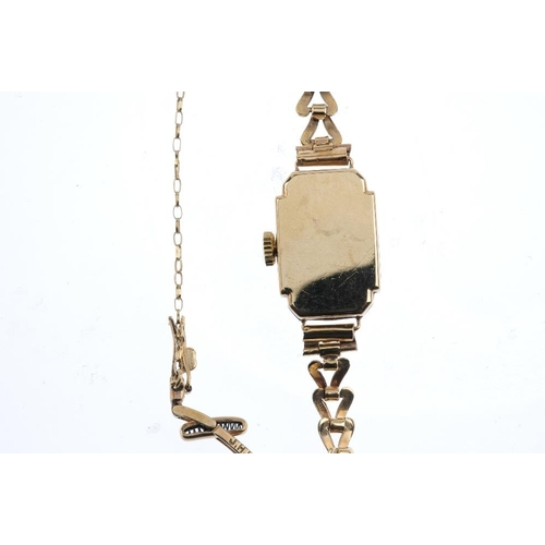 996 - A 9ct gold ladies manual-wind wristwatch. The square-shape cream dial with golden coloured Arabic nu...