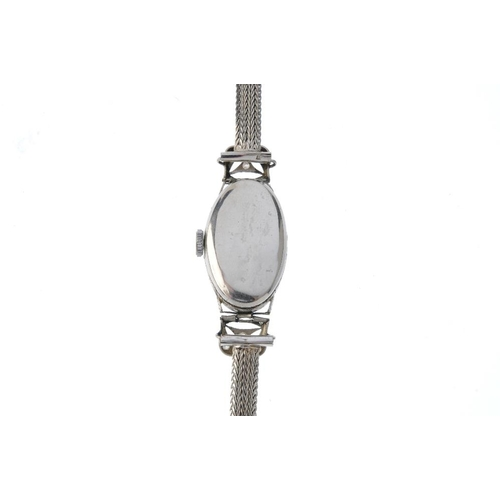 997 - A lady's diamond cocktail watch. The oval cream dial with graduated black Arabic numerals and circul...