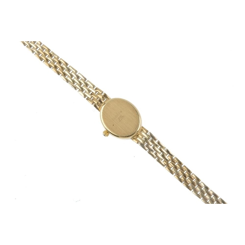 999 - A lady's 9ct gold watch. The oval-shape dial, with baton hour markers, to the graduated brick-link b...