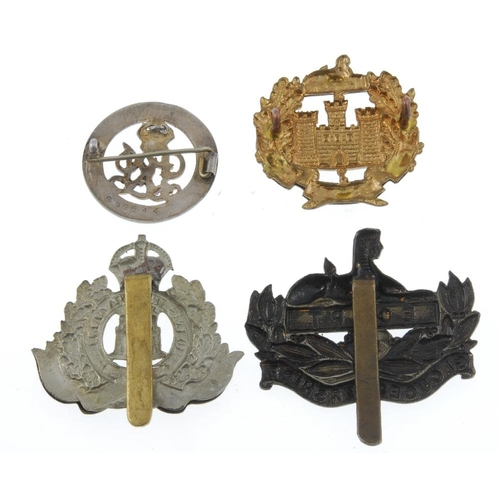 278 - A large quantity of military badges comprising, a silver War Badge, numerous cap badges from a selec...