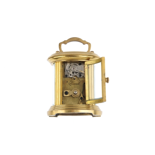 838A - A 20th century oval mignonette carriage clock. The white Roman dial marked 'FRANCE', the single-trai...