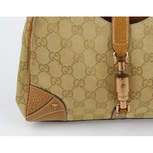 93d756770c2a 161 - GUCCI - a small Bardot handbag. Designed with a beige GG monogram  exterior