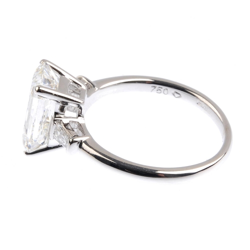 166 - An 18ct gold diamond single-stone ring. The rectangular-shape diamond, weighing 3.20cts, with tapere...