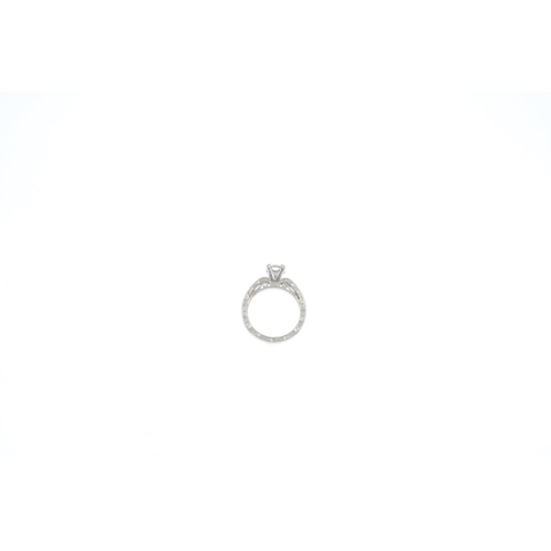 1 - A diamond single-stone ring. The brilliant-cut diamond, weighing 0.64ct, with scrolling engraved gal...