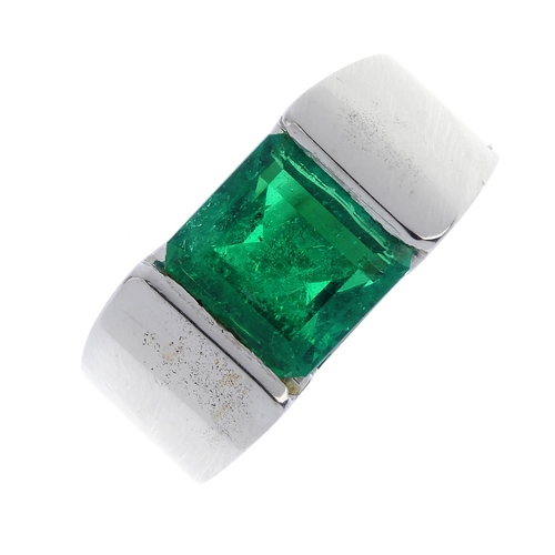 10 - A Colombian emerald single-stone ring. The square-shape emerald, with tapered band. Verbal from GCS,...