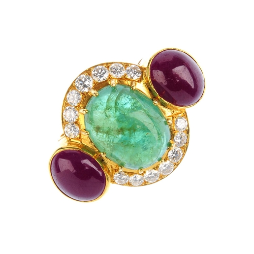 100 - VOURAKIS - a ruby, emerald and diamond ring. The oval emerald cabochon, with oval ruby cabochon side...