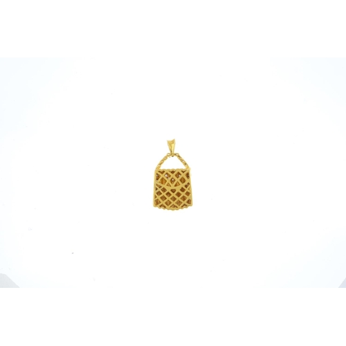 101 - A diamond handbag pendant. Designed as a grooved handbag, with brilliant-cut diamond handle and simi...