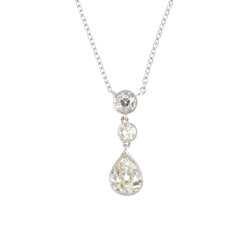 102 - A diamond pendant. The pear-shape old-cut diamond collet, with brilliant-cut diamond spacer and old-...