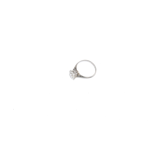 103 - A diamond single-stone ring. The brilliant-cut diamond, with scrolling openwork gallery and tapered ...