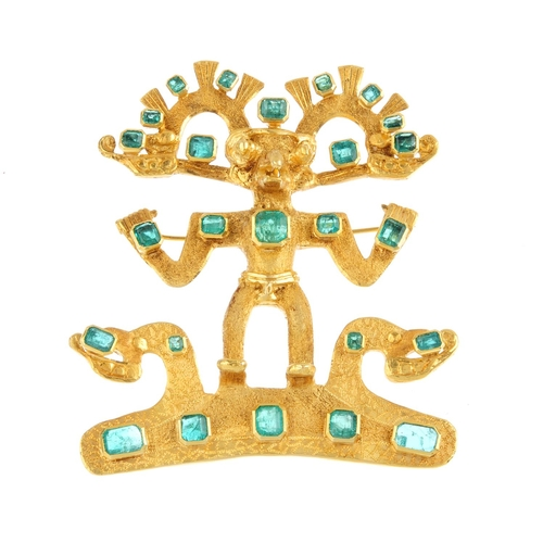 105 - An emerald Pre-Colombian idol brooch. Designed as a Pre-Colombian god, with vari-shape emerald highl...