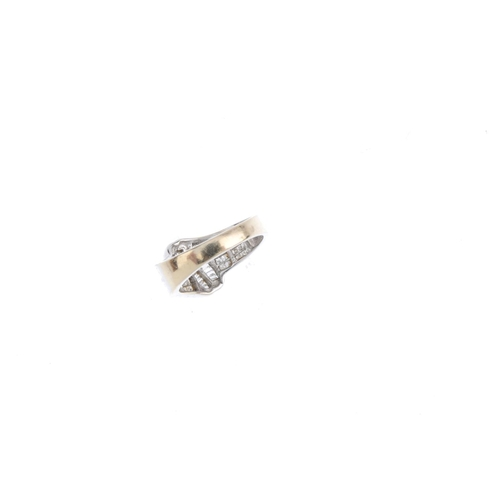 106 - A diamond dress ring. Designed as a series of baguette-cut diamond scrolling lines, with square-shap...