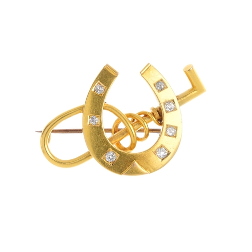 107 - A late Victorian gold diamond brooch. Designed as an old-cut diamond accent horseshoe, atop a riding...